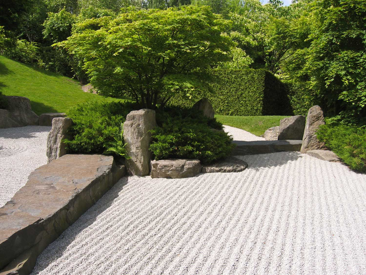 Natural boulders as artistic features for Japanese garden designs